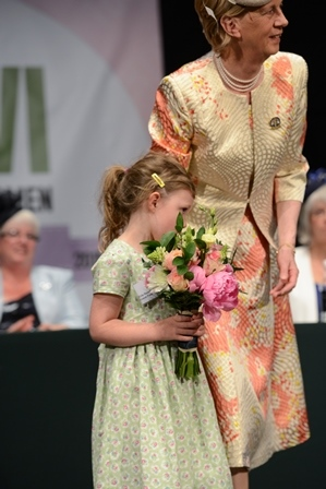 Diana's granddaughter about to present a bouquet