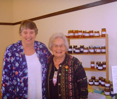 Sue Kendall, County Chairman, with Jackie Gregory of ACWW with some of the jams she has made to raise funds for ACWW